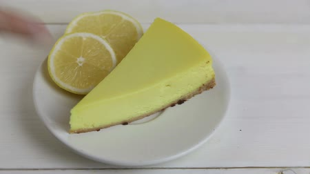bolo de queijo : delicious cheesecake with lemon on plate