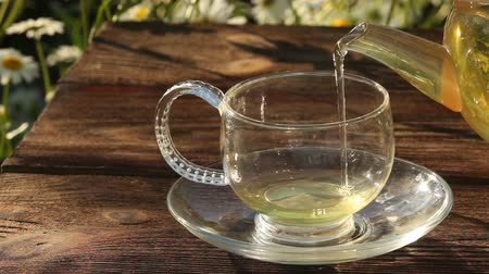 основа : Crystal cup with green tea on table