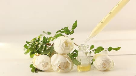 essence of flowers : Essence of flowers on white background in beautiful glass jar