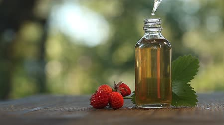 wild strawberry extract : Essence of Wild strawberry on table in beautiful glass jar