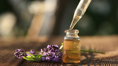 oliwa : lavender essential oil in beautiful bottle on table