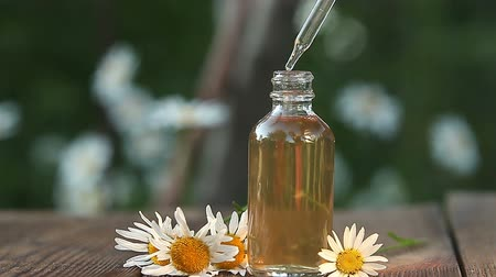 infusion : Essence of flowers on table in a beautiful glass bottle