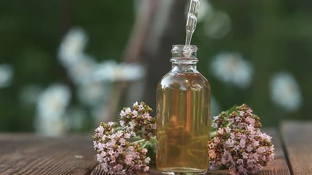 oregano : Essence of flowers on table in a beautiful glass bottle