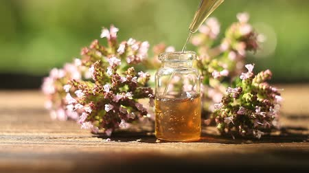 oregano : Essence of flowers on a table in a beautiful glass jar