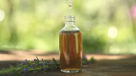 aromaterapia : hyssop essential oil in beautiful bottle on table