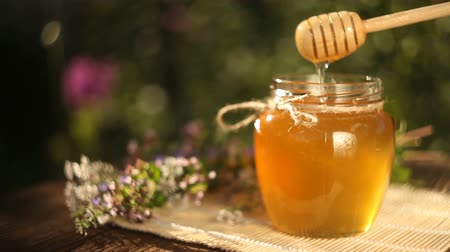 Delicious delicious honey in jar on table Stock mozgókép