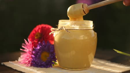 Delicious delicious honey in jar on table Stok Video