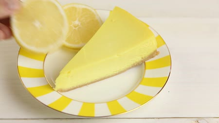 delicious cheesecake with lemon on plate