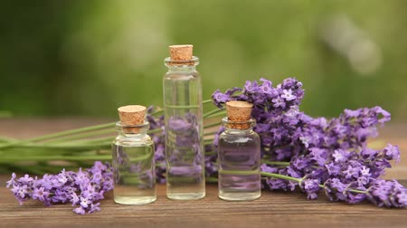 essence of flowers : lavender essential oil in beautiful bottle on table