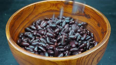 bezelye : Red beans.Red beans flow in slow motion Stok Video