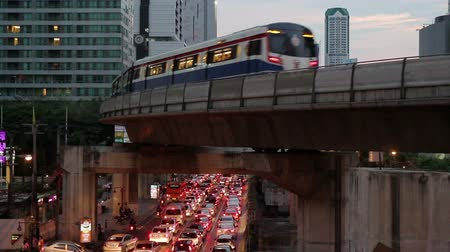 office life : Public train transport, sky train runs through skyscraper, office building, business tower, traffic jam in Rush Hour in City Center, downtown of Bangkok Thailand