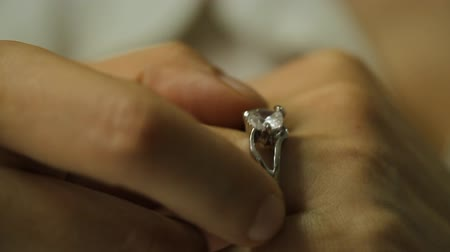 heart failure : Divorce, a woman hand take off a diamond ring from the finger