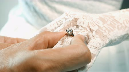 vdo : Diamond rings in wedding day %u2013 groom puts a wedding ring on finger of a bride. Close up on hand of a man put an engagement ring on the finger of girl of just married couple. Video shot on VDO 4K.