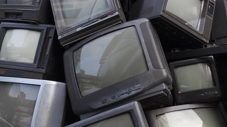 dated : Dolly, Tilt up VDO of old television electronic junk, garbage, rubbish. Video 4K of broken TV stacked show in recycle concept and environmental theme fair. Good for background title, end credit