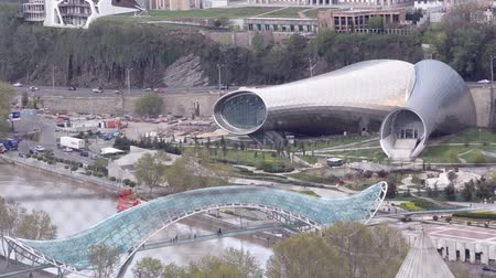 cura : Tbilisi, view of the glass bridge of peace and music theater and drama