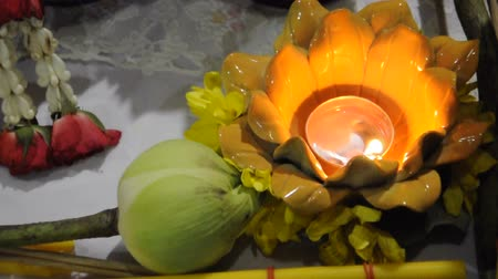oblation : Flame in the ceramic lotus and flowers for worship buddha