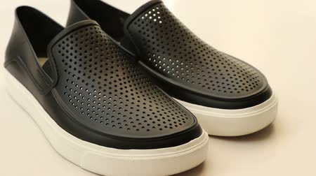 тапочка : Black rubber casual shoes on white background
