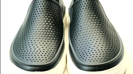 papucs : Black rubber casual shoes on white background