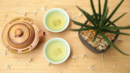hot pot : Green tea set on wood table, Top view with copy space