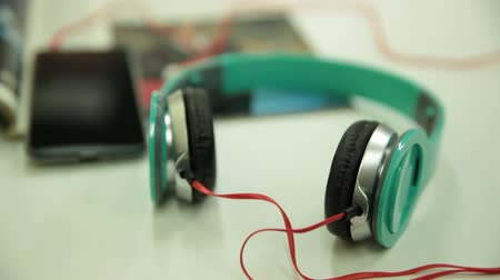 Headphones with Smartphone and Music Magazine