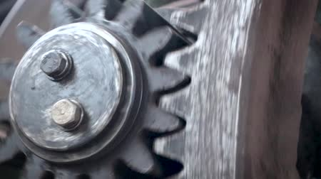 cogwheels : Gears of a large machine are spinning fast. The mechanism of the machine.