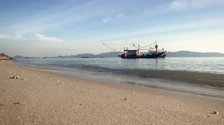 A big fishing boat on the water. Small waves on the sea. Tropical beach. Wideo