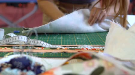 cutting mat : The dressmakers desk. The tailor works with a jacquard cloth.