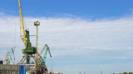 container terminal : The work of the crane in the river port. Fast motion.