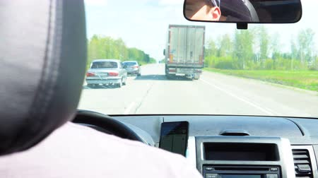 obstacles : Cars overtake a truck on the road passing through the forest. Stock Footage