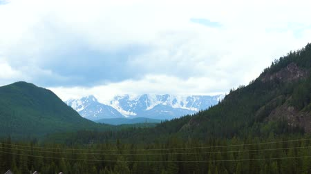glacier national park : View from the car on the snow-covered mountain range. Stock Footage