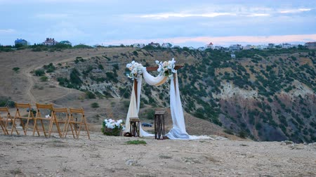 natural arch : The wedding arch stands on the edge of the mountain near the sea.