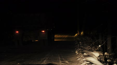 brake : A truck carrying ore rides along a forest snowy road in the winter season. Night time. View from the front window of the car. Stock Footage