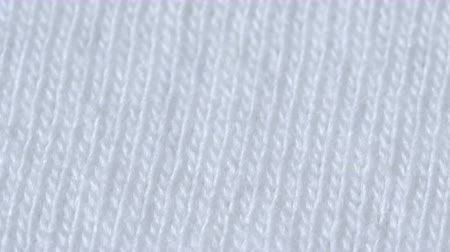 вязание : Textile background - white 100 cotton cloth with jersey (stockinette) structure. Weave pattern of threads close up.