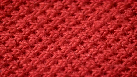 szczupak : Red cotton fabric with polyester, which is used for sewing polo shirts. Weave a pike. Macro shoot. Close up.