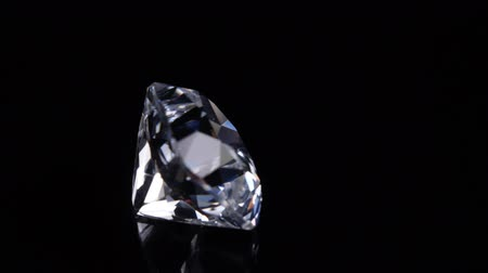 emtia : The gem revolves around its axis. Black background.