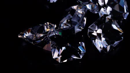 diamond dust : Gemstones rotate on a stand on a black background. Close up. Stock Footage