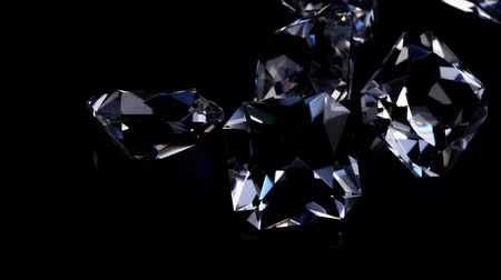 facets : Gemstones rotate on a stand on a black background. Close up. Stock Footage