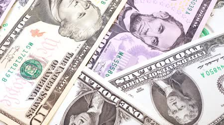 пять : Banknotes in denominations of one to ten USA dollars. Rotation paper money close-up.