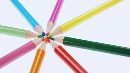 childrens : Multicolored colorful childrens pencils rotate on a white background. Close up. Stock Footage