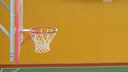 requiring : Basketball ball flies into the basket in the old sports hall. Slow motion. Stock Footage