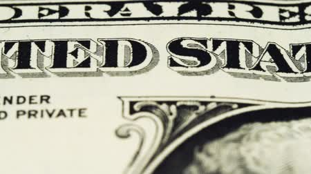 Sliding video of a one US dollar bill note, showing The United States of America text. Macro shot. Close up. Stock Footage