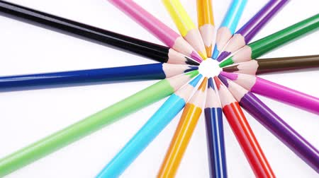 Multicolored colorful childrens pencils rotate on a white background. Close up. Macro shot. Wideo