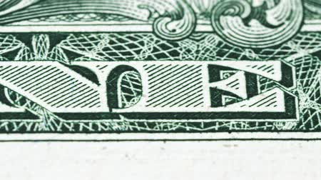 Sliding video of a one US dollar bill note, showing One Dollar text. Macro shot. Close up. Wideo