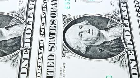 Sliding video of a one US dollar bill note, showing the portrait of US President George Washington. Macro shot. Close up.