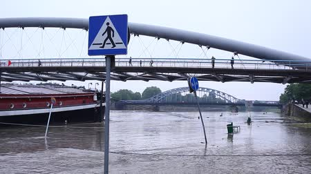 wisla : Flood. Sidewalk covered with water from the river in Krakow, Poland. Stock Footage