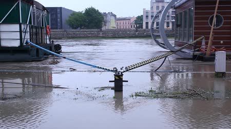 wisla : Flood. Sidewalk covered with water from the river in Krakow, Poland. Boats used as restaurants are closed.