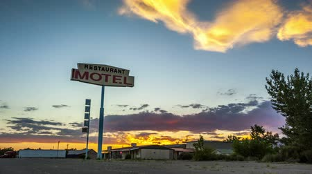znak :  Beautiful sunset behind Restaurant Motel sign Wideo