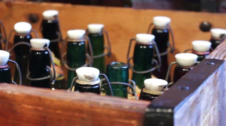 cervejaria : Green bottles with a vintage cap in wooden box