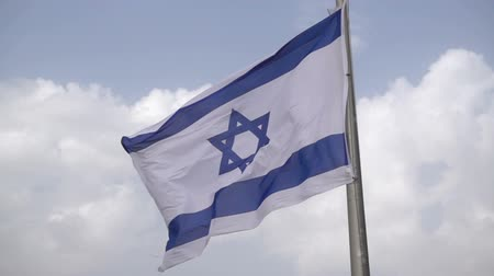 blue flag : Israeli flags waving on the wind in slow motion