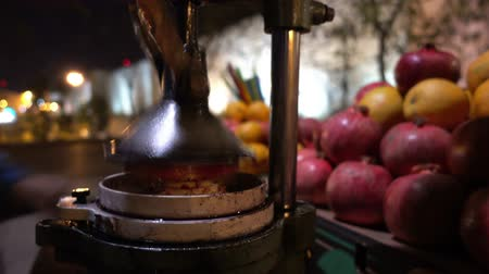 roma : Making pomegranate juice to street seller.
